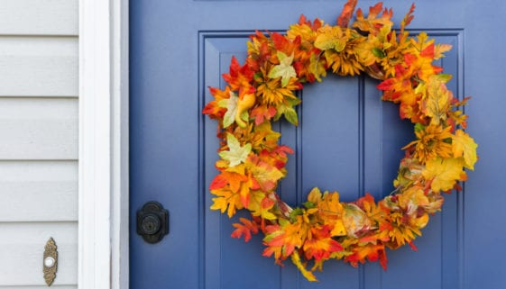 Blue front door with festive autumn wreath