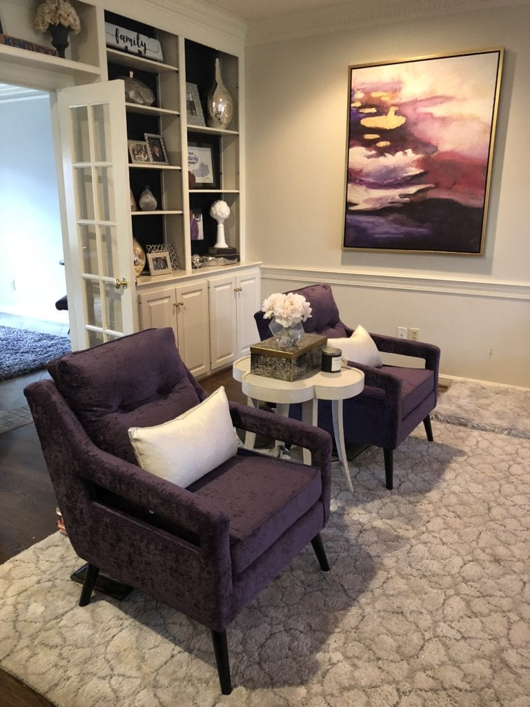 Sitting room with purple chairs