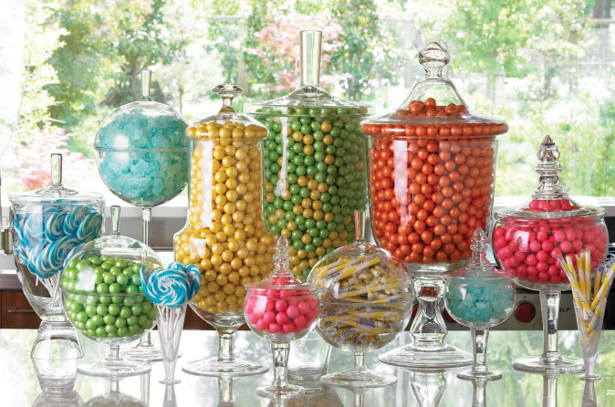 Assorted color candies in glass vases